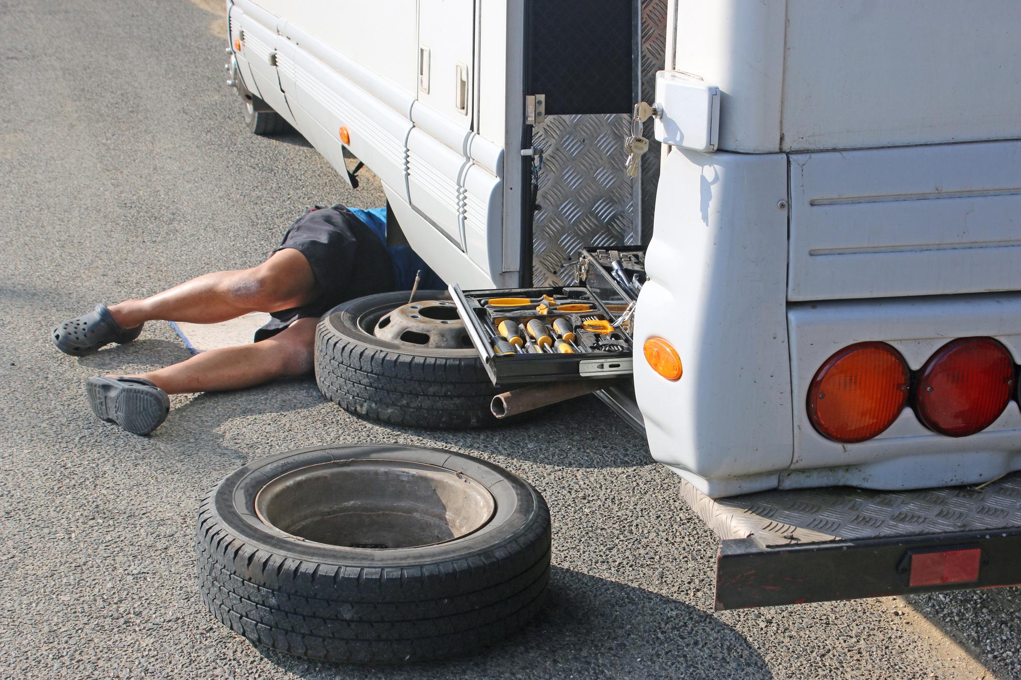 man repairing RV