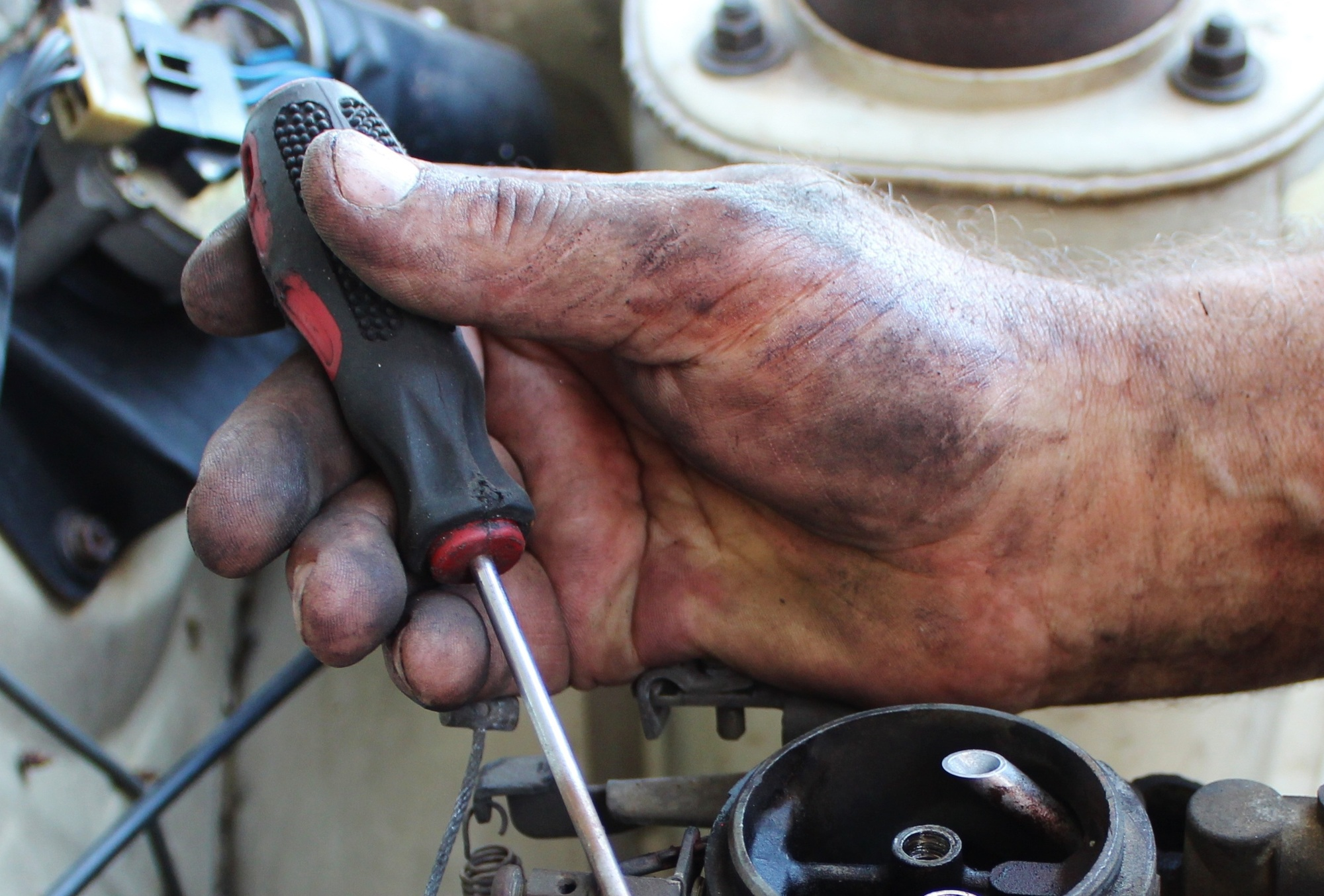mechanic's hand with screwdriver