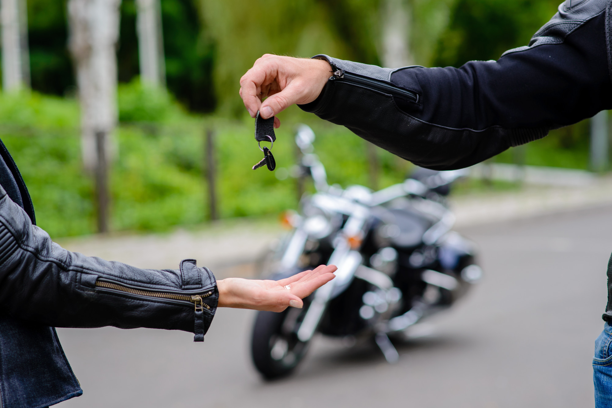 handing over motorcycle keys